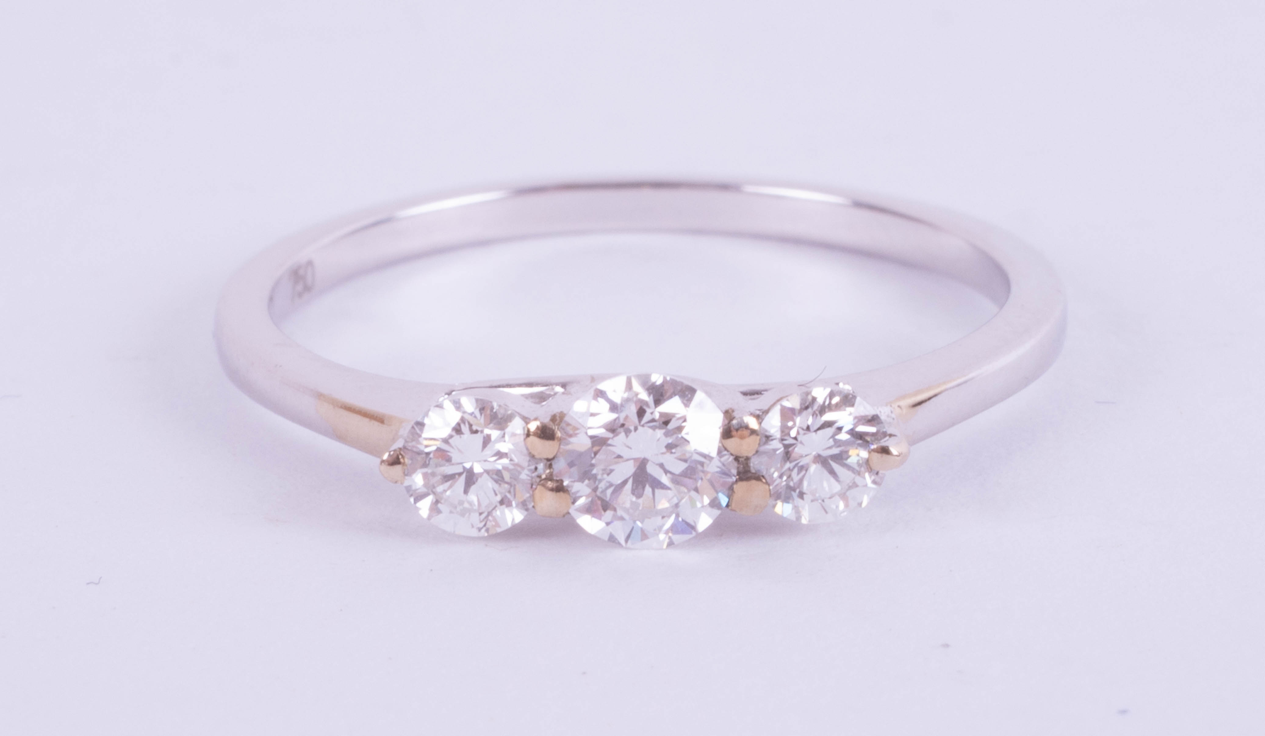 An 18ct white gold trilogy ring, approx. 0.50ct, estimated colour E, clarity SI1, ring size M.