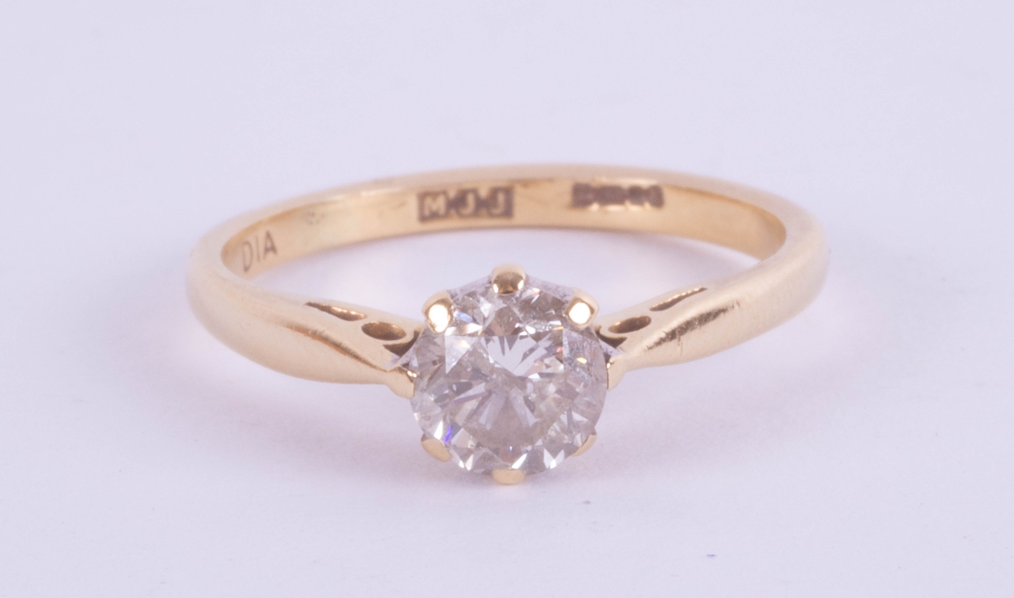 An 18ct yellow gold diamond solitaire ring approx. 0.50ct, ring size J.