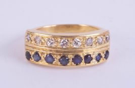 An 18ct sapphire and diamond two row ring, set with 16 stones in yellow gold, ring size N.