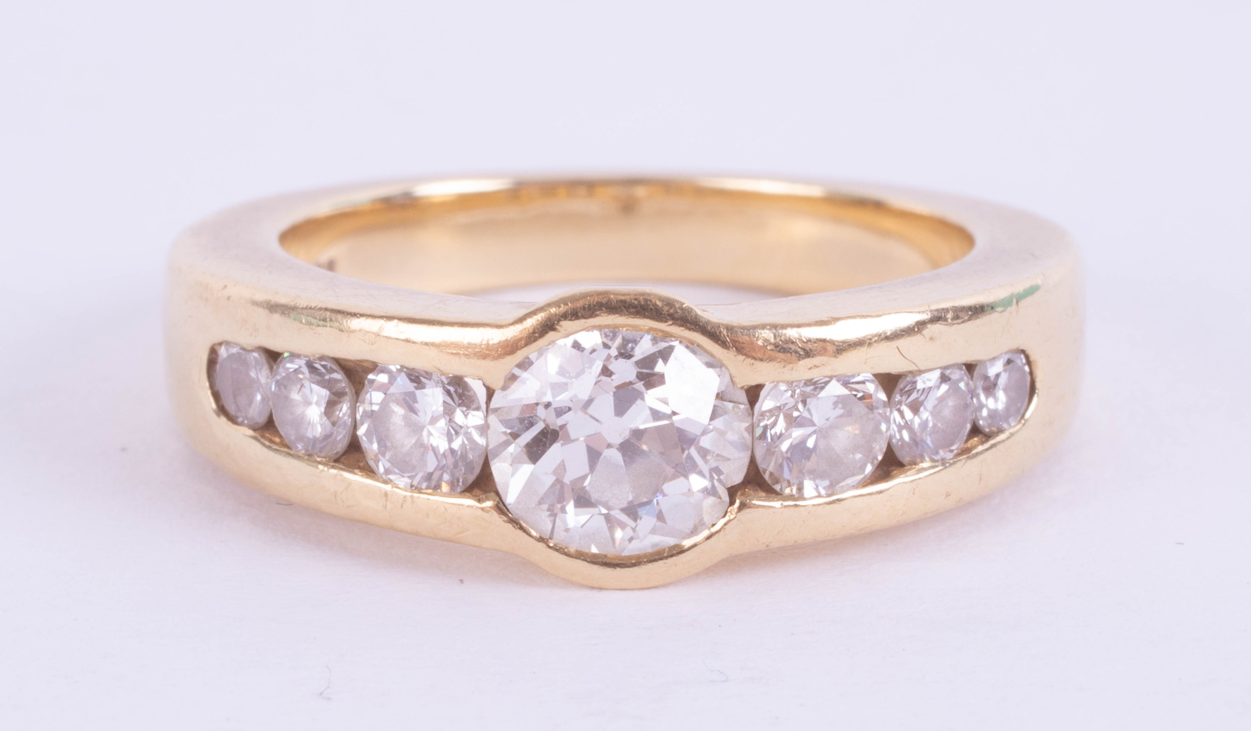 An 18ct diamond set seven stone ring, the central diamond approximately 0.80ct, with a copy of a