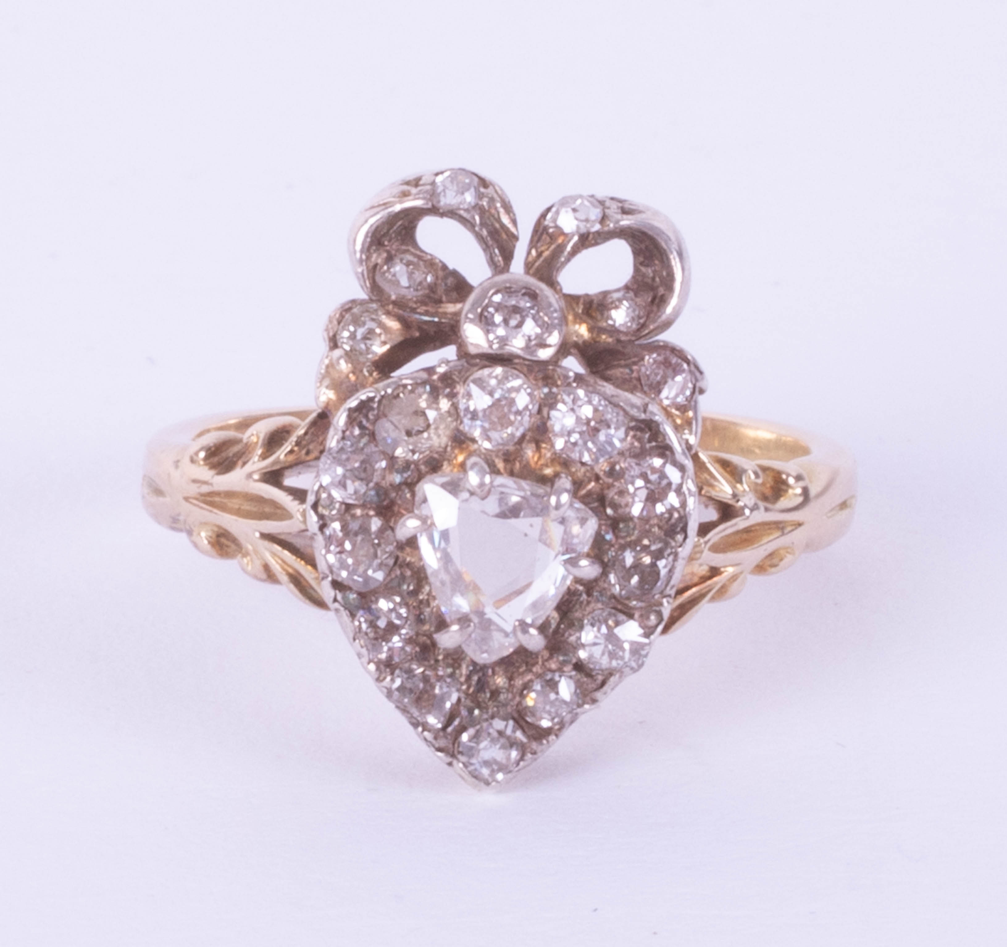 A Victorian diamond set heart ring, size J, boxed.