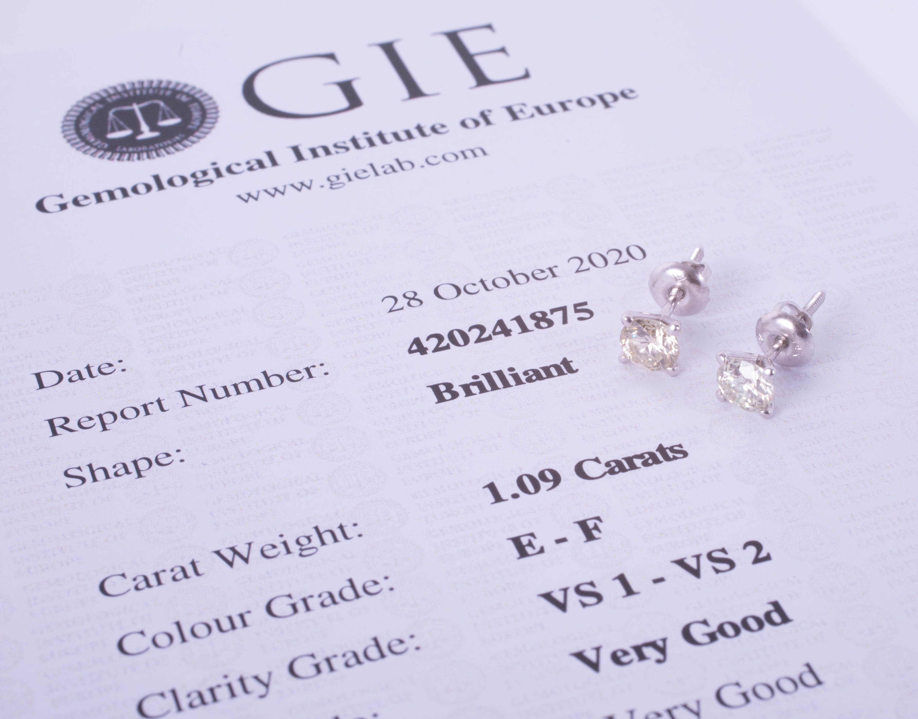 A pair of 14k white gold and diamond earrings, weight 1.09 carat, colour E-F, clarity VS1-VS2 - Image 2 of 2