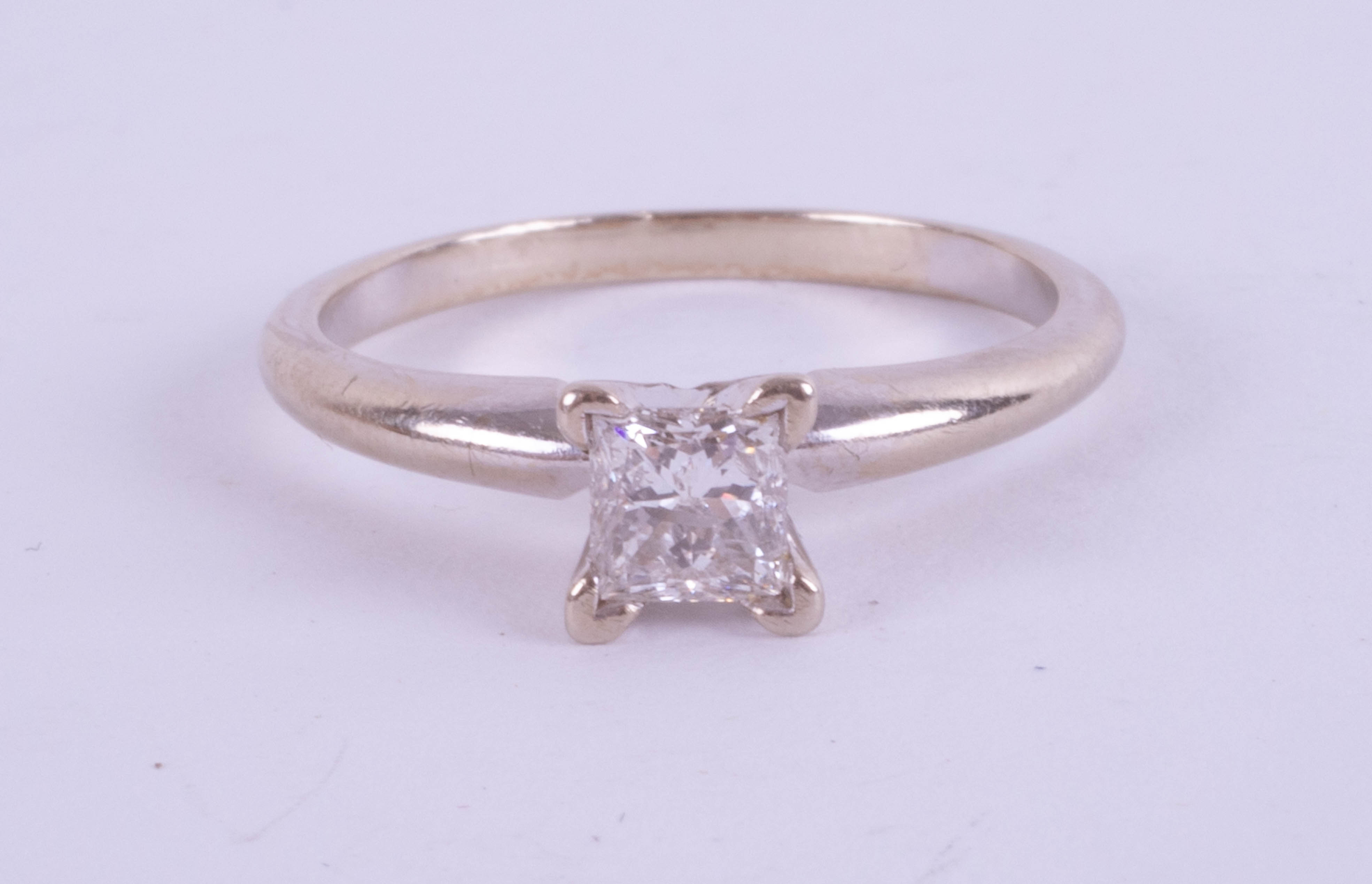 An 18ct white gold princess cut diamond ring, approx. 0.45ct, ring size I.