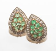A pair of 9ct emerald and diamond pear shaped earrings.