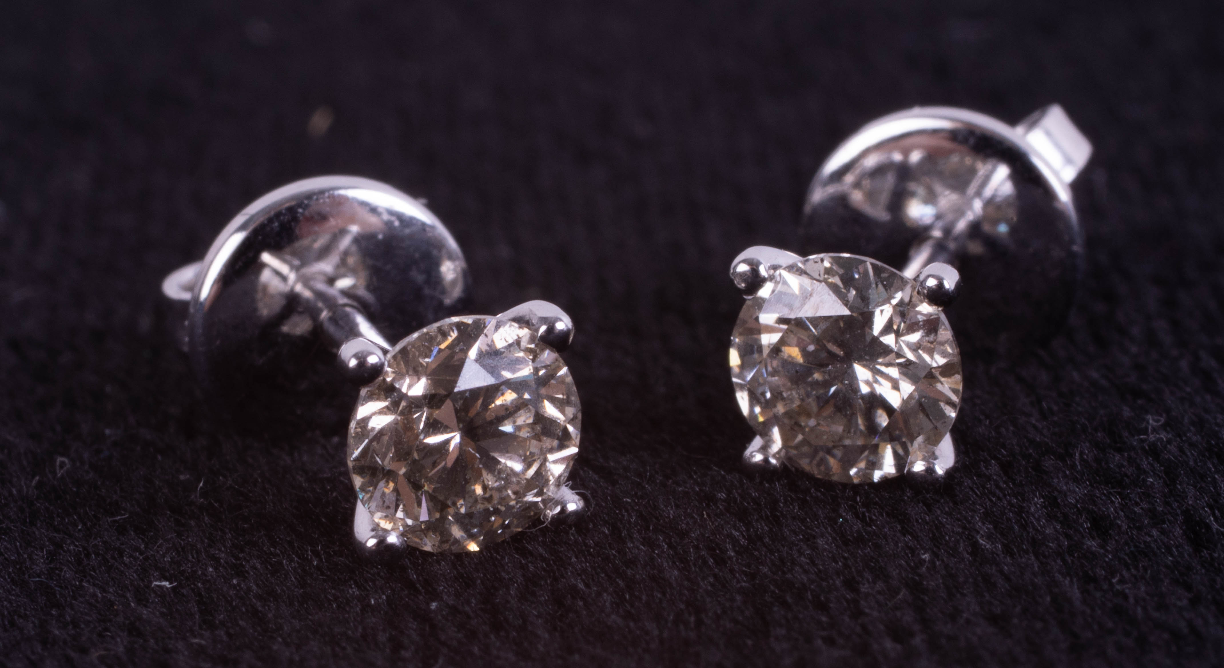 A pair of 18ct white gold solitaire diamond stud earrings, boxed. RBC diamonds approx 1.07ct.