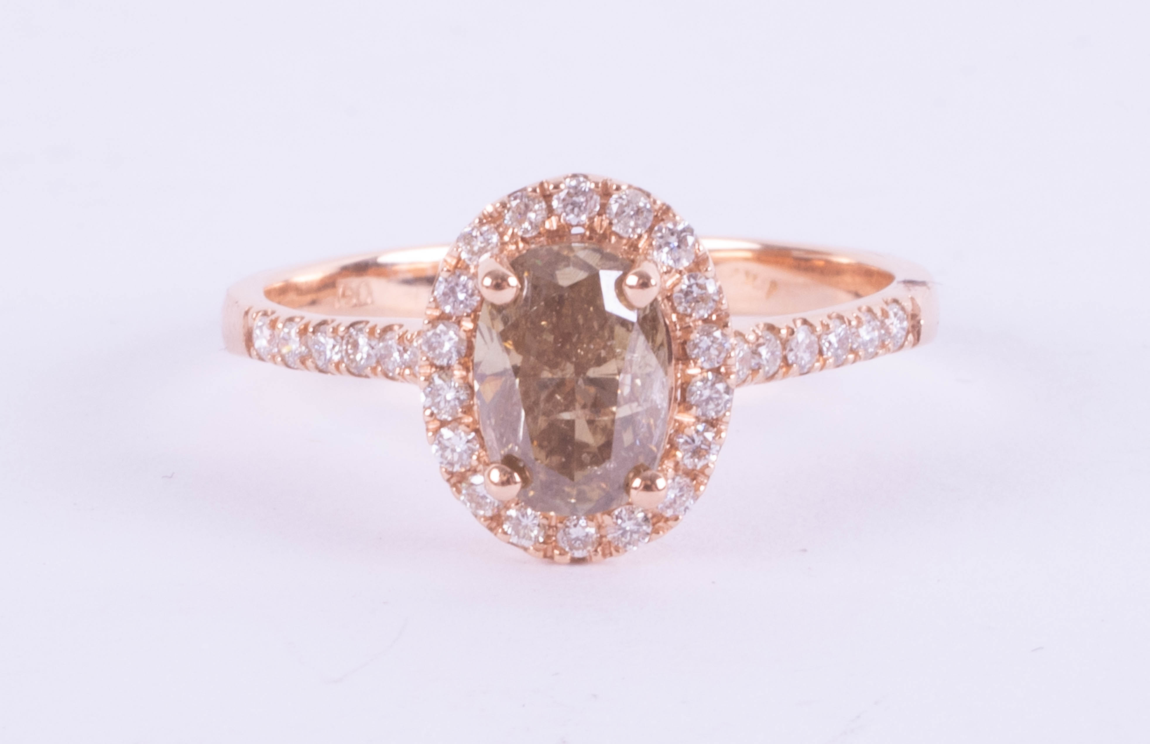 An 18ct rose gold champagne diamond halo set ring, approx. 1.10ct, ring size O.