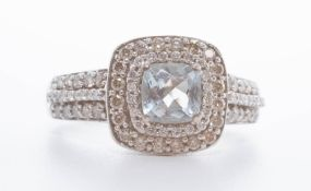 A 14ct aquamarine and diamond set cluster ring in white gold, size T.