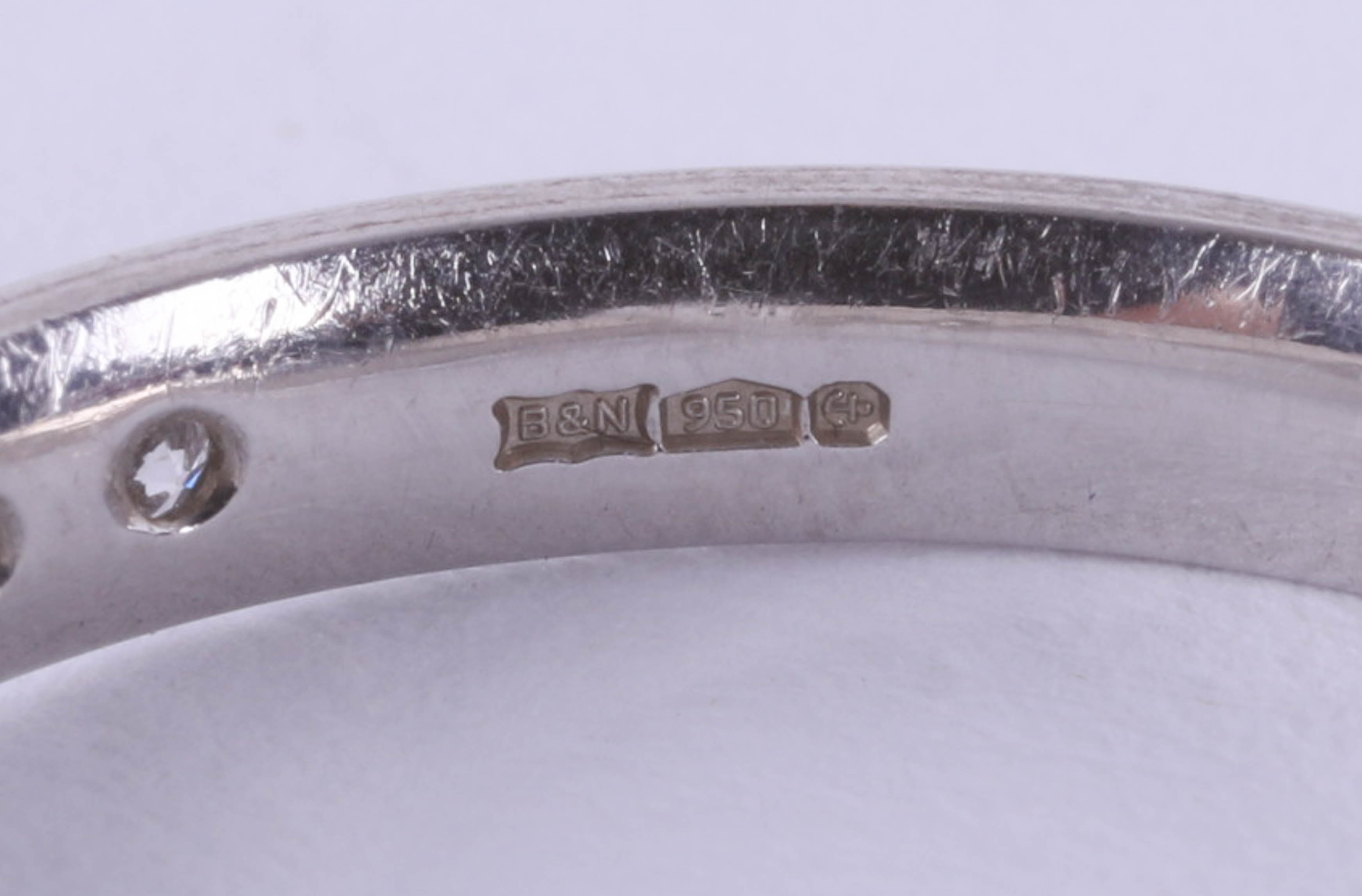 A platinum and diamond set band ring, size N. - Image 3 of 4