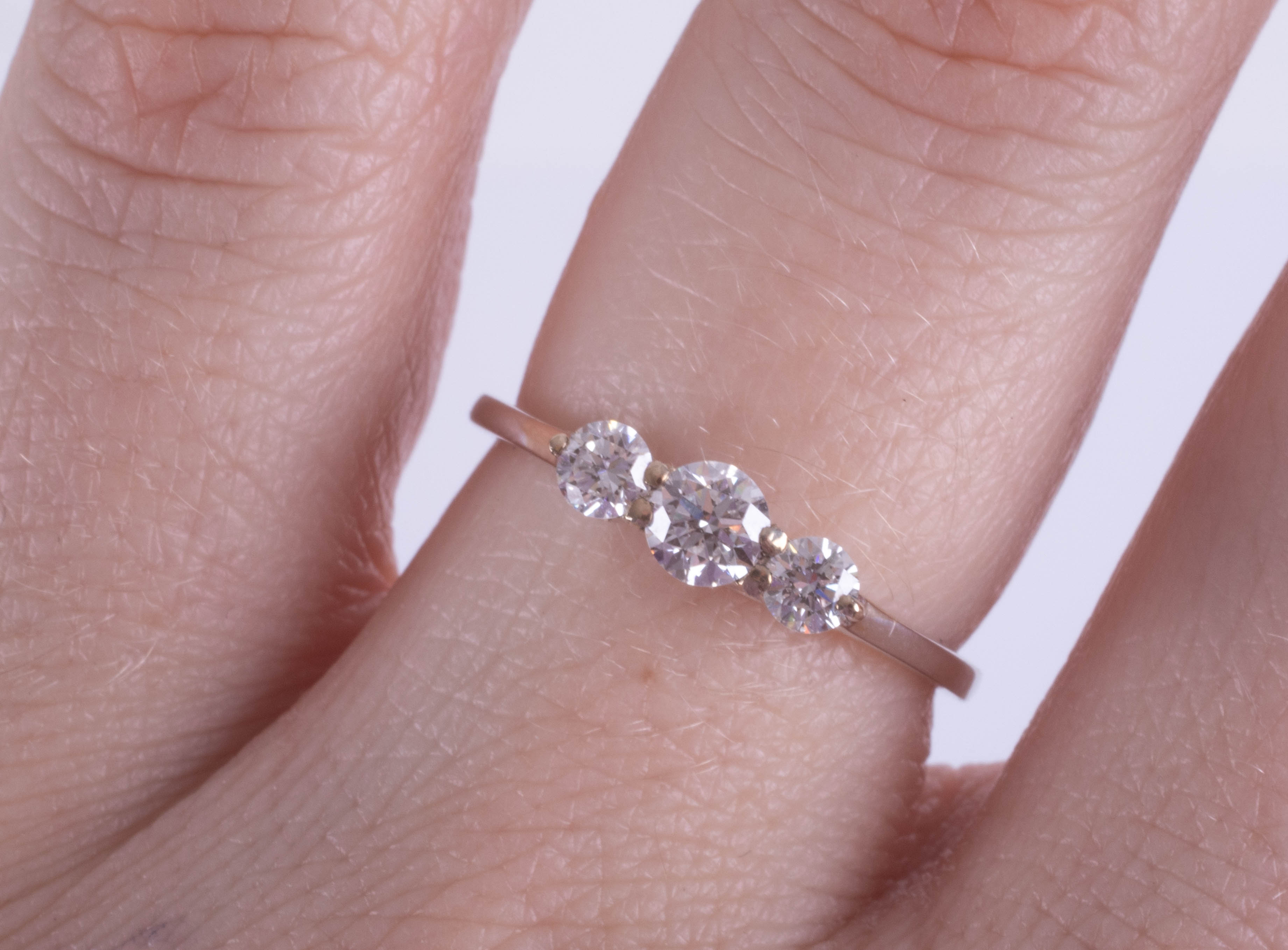An 18ct white gold trilogy ring, approx. 0.50ct, estimated colour E, clarity SI1, ring size M. - Image 2 of 2