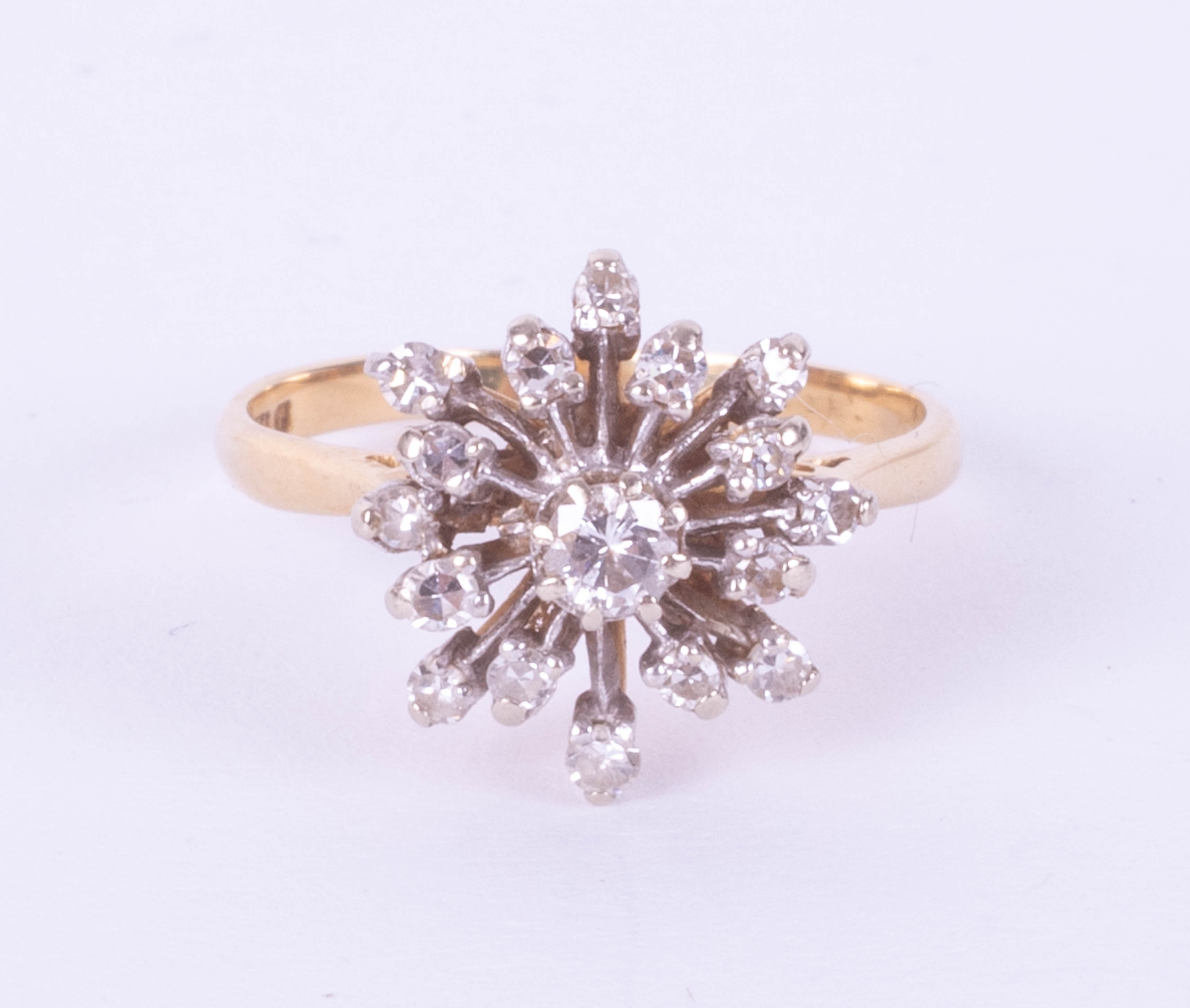 An 18ct diamond cluster ring set in yellow gold, size N.