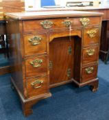 A Georgian mahogany knee-hole desk of small proportions, with brass swan neck handles, width 75cm,
