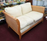 Bergere, a modern light wood, three piece lounge suite, with double cane sides and back.