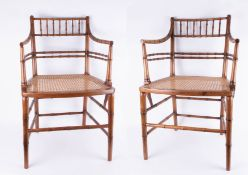 A set of six early 20th century faux bamboo dining chairs with later cane seats (four plus two).