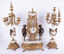 A large continental gilt and marble style three piece clock garniture set decorated with cherubs,