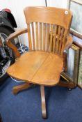 An oak office swivel chair, early 20th century.