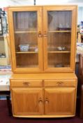 Ercol, a light wood and glazed side cabinet bookcase, width 91cm, height 162cm.
