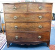 A 19th century mahogany bow fronted chest of five drawers on splayed black bracket feet, width