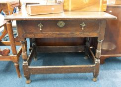 An antique oak side table, fitted with a single drawer on turned legs with stretchers, width 90cm.