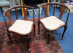 A pair of mahogany framed corner chairs.