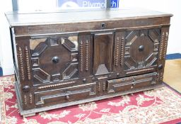 An 18th century oak coffer with geometric mouldings and scratch carved date of 1753 (faults) width