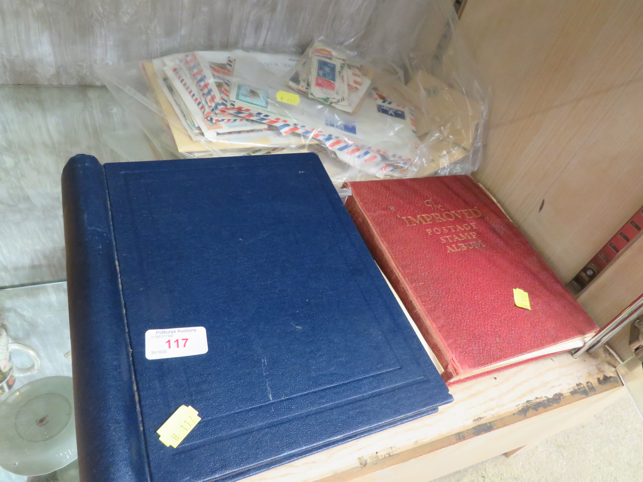 BLUE ZENITH STAMP ALBUM AND RED IMPROVED POSTAGE STAMP ALBUM WITH CONTENTS, TOGETHER WITH COVERS AND