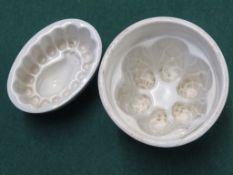 TWO SMALL PORCELAIN BLANCMANGE OR PATE MOULDS, THE SMALLER INDISTINCTLY MARKED COPELAND