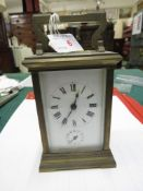 BRASS CASED CARRIAGE ALARM CLOCK, MOVEMENT MARKED MADE IN FRANCE
