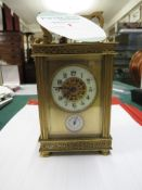 GILT BRASS CASED CARRIAGE ALARM CLOCK, ARABIC CHAPTER WITH PIERCED WORK TO DIAL, UNSIGNED