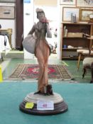 RESIN FIGURE OF LADY WITH PUG DOG, IMPRESSED MARKS, ON WOODEN BASE MARKED MADE IN ITALY WITH THE