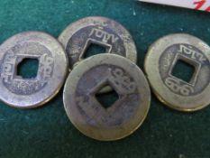 FOUR FAR EASTERN BRASS COINS