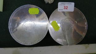 A PAIR OF SMALL CIRCULAR INDIAN WHITE METAL DISHES STAMPED WITH ELEPHANT AND OTHER STAMPED MARKS (