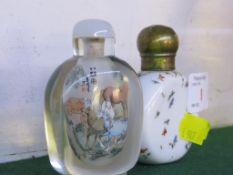 WHITE PORCELAIN SNUFF BOTTLE OF FLATTENED FORM ENAMELLED WITH COLOURED PETALS, BRASS LID (HEIGHT 7.