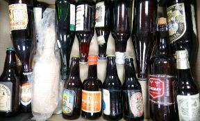 A collection of vintage beer bottles: All unopened including commemorative bottles of 182 Christmas