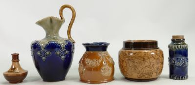 A collection of Doulton Lambeth Stoneware items: Including a ewer, small planters, vases etc.