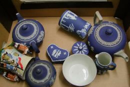 A Collection of Wedgwood Dip Blue: to include Teapots, water jugs, lidded boxes etc ( damages noted)
