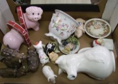 A collection of Pig Theme Pottery Items: