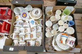A large collection of commemorative mugs, cups etc: 2 trays