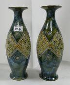A pair of Doulton Lambeth art nouveau vases: by Linnie Watt, circa 1905.