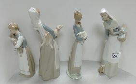 Three Lladro figures of girls carrying sheep: models 4584, 4505,