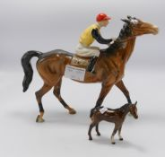 Beswick Jockey on brown horse 1037 damaged: together with damaged small foal(2)