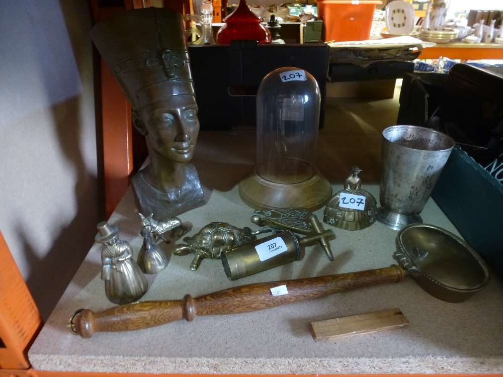 Lot 207 - A selection of brassware including bells and a resin head
