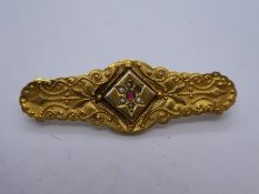9ct Victorian bar brooch of floral design marked 9ct, approx 4cm, weight approx 2.2g, one small seed