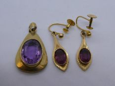 9ct amethyst set pendant and pair of 9ct clip on amethyst earrings, both marked 9ct, gross weight ap