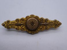 Victorian 9ct yellow gold bar brooch with small starburst set diameter, marked 9carat, AF, weight ap