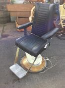 An electric dentists or barbers chair, the adjustable seat with chrome footrest revolving on