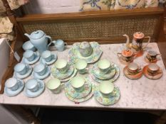 A pale blue Shelley six-piece coffee set with gilt rims and scrolled handles; a Shelley chintz