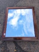 A Victorian rosewood framed mirror, the later plate in cushion moulded frame. (27.5in x 24.25in)