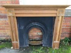 A pine chimneypiece with shelf above a dentil cornice, the frieze and jambs of moulded channelled