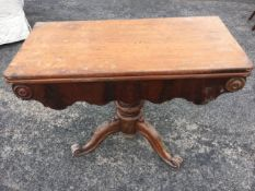 A Victorian mahogany turn-over-top tea table, the rounded twin top above a shaped apron with applied