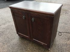 A Philips oak cased hostess trolley with sliding top revealing glass tureens & covers, having